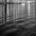 Long Reflections Of Downtown West Palm Beach In Radiant Black An by Debra and Dave Vanderlaan