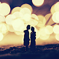 Loving Couple Standing In A Cozy Winter Scenery. by Michal Bednarek