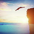 Man Diving Into Water From High Cliff To The Unknown. by Michal Bednarek