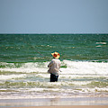 Man Fishing In The Surf by Cynthia Guinn