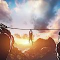 Man Hanging On Rope Between Two High Mountains by Michal Bednarek