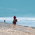 Man Riding On A Brown Galloping Horse On Ayia Erini Beach In Cyp by Iordanis Pallikaras
