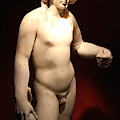 Marble Statue Of Man With Grapes At Pompeii Exhibit by Colleen Cornelius