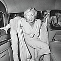 Marilyn Monroe Boarding A Car by Bettmann