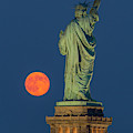 Moon Rise By Statue Of Liberty by Susan Candelario