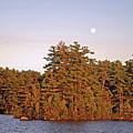 Moonrise Over The Island In Late Day Light  by Lynda Lehmann