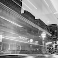Moving Through Denver Colorado - Black And White by Gregory Ballos