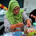 Muslim Thai Woman Cook At Street Stall At Food Street Bazaar Pattani Thailand by Imran Ahmed