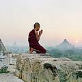 Myanmar, Bagan, Buddhist Monk Praying by Martin Puddy