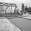 Nashville Skyline And Pedestrian Bridge - Monochrome by Gregory Ballos