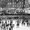 Night Skating At Rockefeller Center by John Rizzuto