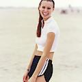 Niki Taylor In Adidas Shorts On The Beach by Arthur Elgort