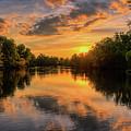 Oak Island At Sundown by Dale Kauzlaric