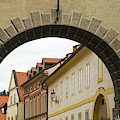 Old Archway With A View Of Pretty Buildings by Les Palenik