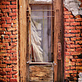 Old Door On An Old Store by James Eddy