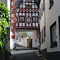 old historic street and woodframed house in Ediger Germany by Victor Lord Denovan