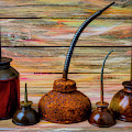 Old Rusty Oil Cans by Garry Gay