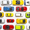Overhead View On Colorful Car Toys by Pirke