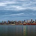 Panorama Of Seattle Skyline At Night With Storm Clouds by PorqueNo Studios