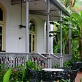 Patio And Balcony With Metal Furniture In Colonial Setting Raffles Hotel Singapore by Imran Ahmed