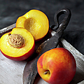 Peaches With Knife On Tray, Close Up by Westend61