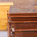 Pews In Old Stonework Church At Fort Stanton New Mexico by Colleen Cornelius
