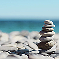 Pile Of Stones On Beach by Dhmig Photography