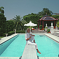 Pool And Parasol by Slim Aarons