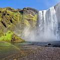 Rainbow Below Skogafoss Waterfall  by Debra and Dave Vanderlaan