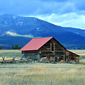 Ranch Building And Mountain Range by Kae Cheatham