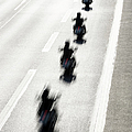 Rear View Of Row Of Motorcycle Riders by Jorg Greuel
