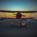 Red Biplane At Dawn by Jeff Kurtz