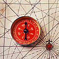 Red Compass On Old Map by Garry Gay