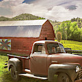 Red Truck At The Red Barn In Summer Light by Debra and Dave Vanderlaan
