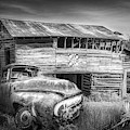 Rust Along A Country Road In Black And White by Debra and Dave Vanderlaan