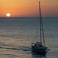Sailboat Heading Home At Sunset Cadiz Spain by Pablo Avanzini