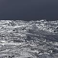 Silvery Sea Waves Reflecting Light by Eastcott Momatiuk
