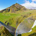 Skogafoss Waterfall In Iceland by Debra and Dave Vanderlaan