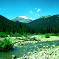Small Stream Foreground The Rockies by Jeff Swan