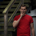 Smoker In Red Tshirt by Juan Contreras