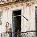 Smoker On Balcony In Cuba by Jennifer Thomas
