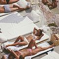 Sunbathers At Eden Roc by Slim Aarons