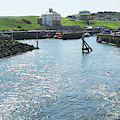 sunlight glistening on water at Eyemouth harbour by Victor Lord Denovan
