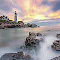 Sunrise On The Rocks At Portland Head Light by Jesse MacDonald