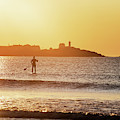 Sunrise Paddle Boarder Paddling By The Nubble Lighthouse From Long Sands Beach Long Beach York Maine by Toby McGuire