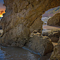 Sunset At The Rock Caves by Lynn Bauer