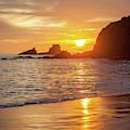 Sunset Over Seal Rocks by Cliff Wassmann