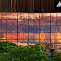 Sunset Reflections On A Wall Of Glass by Ola Allen