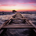 Sunset Shining Over A Wooden Pier In Livorno, Tuscany by Matteo Viviani
