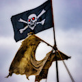 Tattered Sail And Pirate Flag by Garry Gay